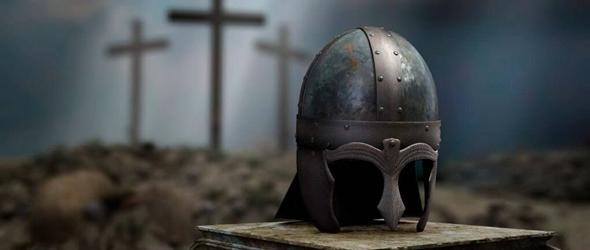 Roman centurion helmet in front of three crosses