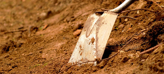 a dirt-covered shovel
